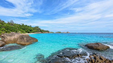 blue widescreen widescreen: Beautiful landscape blue sky sea and waves on beach near the rocks during summer at Koh Miang island in Mu Ko Similan National Park, Phang Nga province, Thailand, 16:9 widescreen Stock Photo