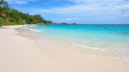 beach: Beautiful landscape of blue sky sea sand and white waves on the beach during summer at Koh Miang island in Mu Ko Similan National Park, Phang Nga province, Thailand, 16:9 widescreen Stock Photo