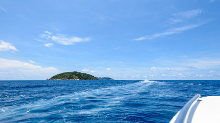 blue widescreen widescreen: Travel by speed boat to islands in the beautiful landscape of blue sea and sky during summer at Mu Ko Similan National Park, Phang Nga province, Thailand, 16:9 widescreen