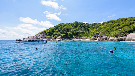 dive trip: Tourists enjoyed snorkelling on blue sea and sky during summer at Ko Ba Ngu Island in Mu Ko Similan National Park, Phang Nga province, Thailand, 16:9 widescreen