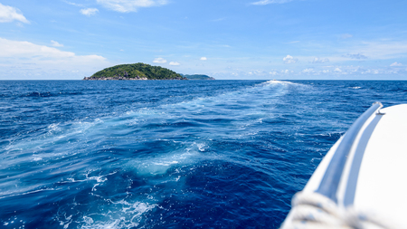 widescreen: Travel by speed boat to islands in the beautiful landscape of blue sea and sky during summer at Mu Ko Similan National Park, Phang Nga province, Thailand, 16:9 widescreen