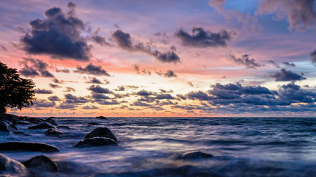 Beautiful landscape of sky and clouds above the sea during sunset at Khao Lak Beach in Khao Lak-Lam Ru National Park, Takuapa, Phang Nga province, Thailand, wide screen 16:9, Tilt-Shift style
