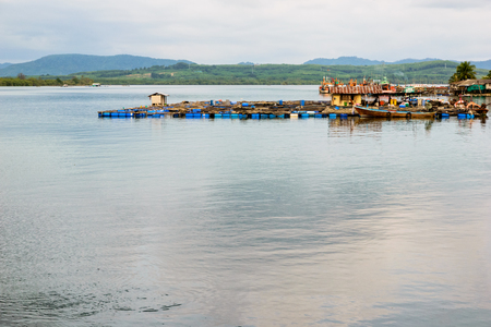 fish rearing: Fish Farm with floating cage at sea in Phuket Province, Thailand