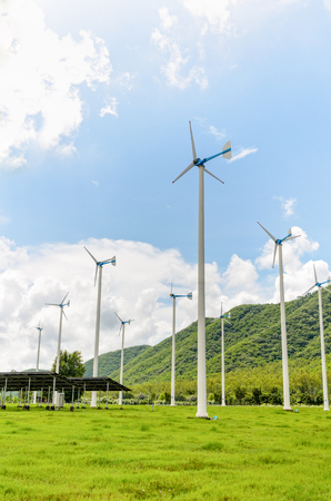 clean energy: Group wind turbine generator of clean energy under the blue sky in Thailand