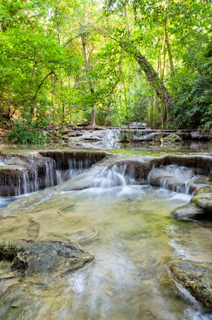 national forests: Beautiful waterfall and tropical forests at Erawan National Park is a famous tourist attraction in Kanchanaburi Province, Thailand