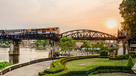 wide screen: Trains for travel running on the old bridge over the River Kwai Yai is a historical attractions during World War 2 the famous of Kanchanaburi Province in Thailand, 16:9 wide screen