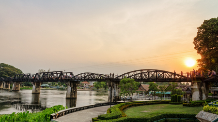 wide screen: Tourist on the old bridge over the River Kwai Yai is a historical attractions during World War 2 the famous of Kanchanaburi Province in Thailand, 16:9 wide screen