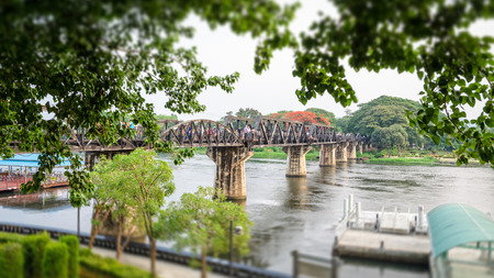 Old bridge over the River Kwai on tilt shift is a historical attractions during World War 2 the famous of Kanchanaburi Province in Thailand,16:9 wide screen