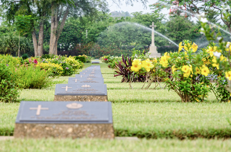 world war 2: KANCHANABURI, THAILAND - MAY 3, 2014: Chungkai War Cemetery this is historical monuments where to respect prisoners of the World War 2 who rest in peace here, MAY 3, 2014 in Thailand Editorial