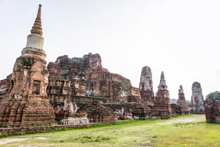 Ancient ruins of pagoda at Wat Phra Mahathat temple is a famous attractions in Phra Nakhon Si Ayutthaya Historical Park, Thailand