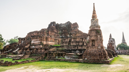 Ancient ruins of pagoda under sun light at Wat Phra Mahathat temple is a famous attractions in Phra Nakhon Si Ayutthaya Historical Park, Thailand Stock Photo