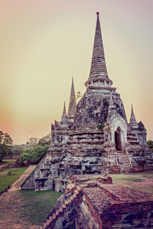 Vintage style add texture effect, ancient ruins and pagoda of Wat Phra Si Sanphet old temple famous attractions during sunset at Phra Nakhon Si Ayutthaya Historical Park, Ayutthaya Province, Thailand