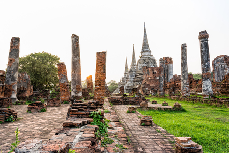 Ruins and pagoda ancient architecture of Wat Phra Si Sanphet old temple famous attractions during sunset at Phra Nakhon Si Ayutthaya Historical Park in Ayutthaya Province, Thailand