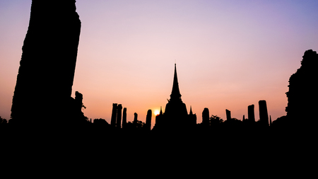 Silhouette for background, Ancient ruins and pagoda of Wat Phra Si Sanphet old temple famous attractions during sunset at Phra Nakhon Si Ayutthaya Historical Park, Thailand, 16:9 wide screen