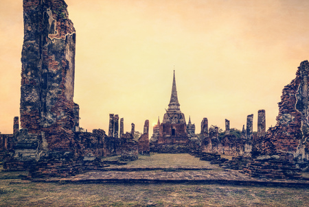 phra nakhon si ayutthaya: Vintage style add texture effect, ancient ruins and pagoda of Wat Phra Si Sanphet old temple famous attractions during sunset at Phra Nakhon Si Ayutthaya Historical Park in Ayutthaya Province, Thailand Stock Photo