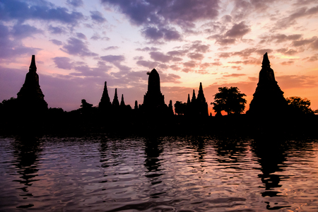 Landscape silhouette of Wat Chaiwatthanaram during sunset next to the Chao Phraya River is ancient temple famous religious attraction of Ayutthaya Historical Park, Thailand
