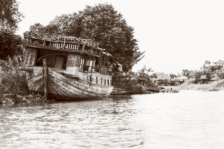 beached: Black and white photo add texture vintage style of the old damaged wooden boat beached on the waterfront for background in Phra Nakhon Si Ayutthaya Province, Thailand