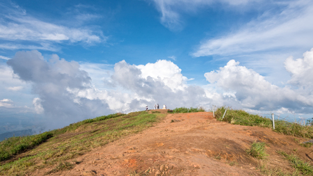 Tourists on the mound and blue sky with white cloud above high mountain at viewpoint of Phu Chi Fa Forest Park in Chiang Rai Province Thailand, 16:9 wide screen