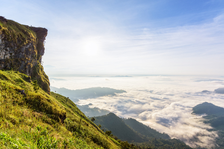 fa: Beautiful landscape nature in morning on peak mountain with sun cloud fog and bright blue sky in winter at Phu Chi Fa Forest Park is a famous tourist attraction of Chiang Rai Province, Thailand
