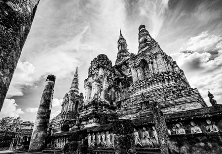 Black and white two tone vintage style, Ancient chapel among the ruins under the bright sky at Wat Maha That temple in Sukhothai Historical Park landmark of Sukhothai Province, Thailand Stock Photo