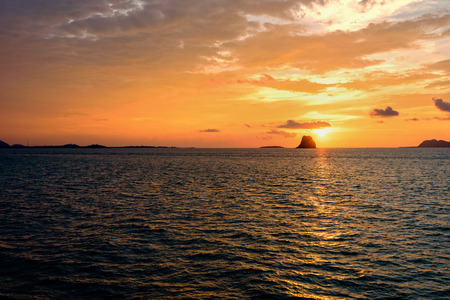 Beautiful natural landscape of colorful cloud sky and sun at sunset over the sea in Surat Thani province, Thailand