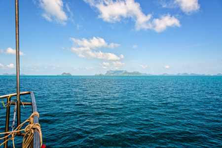 Prow of the boat on the beautiful sea under bright blue sky in summer, overlooking the horizon, is traveling to Mu Ko Ang Thong National Marine Park, Surat Thani province, Thailand. Stock Photo