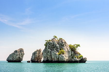Beautiful natural landscape of small island on the sea under bright blue sky in summer at Mu Ko Ang Thong National Marine Park is a famous attractions in Surat Thani province, Thailand