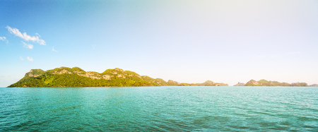 blue widescreen widescreen: Panorama beautiful natural landscape front of the Mu Ko Ang Thong island, National Marine Park on the sea under bright blue sky and sunlight in summer is a famous attractions in Surat Thani, Thailand