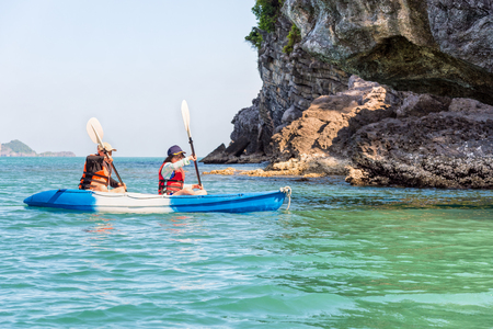 Two women are mother and daughter. Travel by boat with a kayak happy under the blue sky summer around Ko Phi view the beautiful nature of the sea and island, Mu Ko Ang Thong National Park, Surat Thani, Thailand Stock Photo