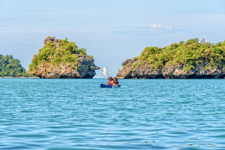 Travel by boat with a kayak around island