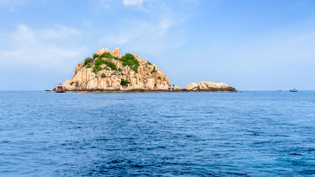 Beautiful nature landscape of Shark Island Divesite on the blue sea, small rock island at Ko Tao during summer is a famous tourist attractions in the Gulf of Thailand, Surat Thani, 16:9 widescreen