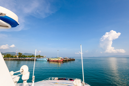 Beautiful natural landscape of sky and blue sea while travel by speed boat in summer arrive at the pier of Ko Pha Ngan island in Gulf of Thailand is a famous attractions of Surat Thani province, Thailand
