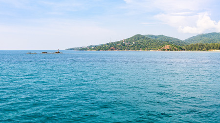 Beautiful nature landscape of blue sky sea and lantern on the rocks in summer at Ko Pha Ngan island in Gulf of Thailand is a famous attractions of Surat Thani province, Thailand, 16:9 widescreen