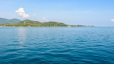 Beautiful nature landscape of sky and blue sea in summer at Ko Pha Ngan island in Gulf of Thailand is a famous attractions of Surat Thani province, Thailand, 16:9 widescreen Stock Photo