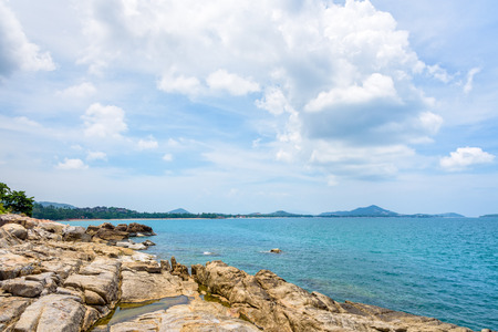 Beautiful natural landscape of rock along the coastline with blue sea under the summer sky at Koh Samui island, Surat Thani province, Thailand