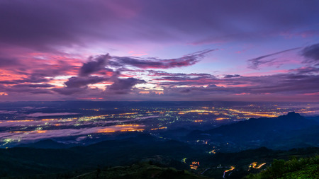 High view beautiful nature landscape of colorful sky during the sunrise see the lights of the road and city at Phu Thap Berk viewpoint, Phetchabun Province, Thailand, 16:9 wide screen Stock fotó