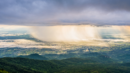 High view beautiful nature landscape of the mountain sky forest and the rain is falling sunlight shining through is golden at Phu Thap Berk viewpoint, Phetchabun, Thailand, 16:9 wide screen