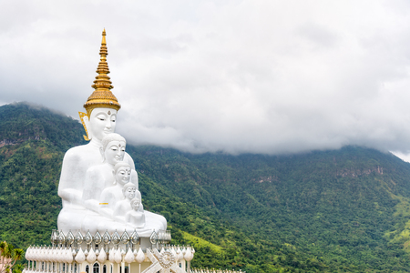 Buddha statue has large white five body on mountain surrounded by nature with cloud fog cover at Wat Phra That Pha Sorn Kaew Temple is a tourist attractions in Khao Kho, Phetchabun, Thailand