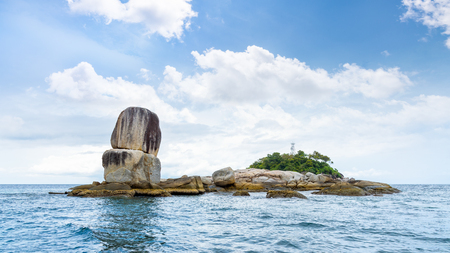 Beautiful nature landscape of Ko Hin Sorn small island with surprisingly overlap rocks in the Andaman Sea and sky in summer attractions near Koh Lipe at Tarutao National Park, Satun, Thailand