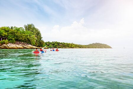 Tourist group are kayaking on the sea, travel by boat to see the beautiful nature landscape in the morning of summer at front the resort around Ko Lipe island, Tarutao National Park, Satun, Thailand