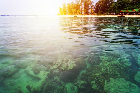 Beautiful nature landscape colorful the sunlight at the sunrise in summer over the clear sea, see the coral reef, beache, tree, resort at North Point Beach, Koh Lipe island, Tarutao, Satun, Thailand