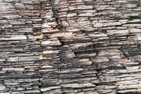 Rough texture pattern of the old black and white grunge stone surface, Strong structure durable nature of rock for abstract background