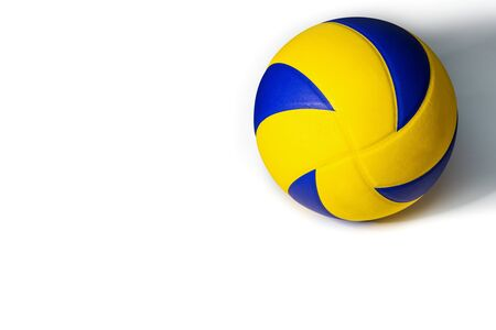 Closeup yellow blue volleyball on a white 免版税图像