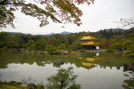 whose: Kinkakuji, Golden Pavilion, is a Zen temple in northern Kyoto whose top two floors are completely covered in gold leaf