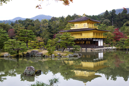 two floors: Kinkakuji, Golden Pavilion, is a Zen temple in northern Kyoto whose top two floors are completely covered in gold leaf