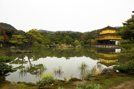 koyo: Kinkakuji, Golden Pavilion, is a Zen temple in northern Kyoto whose top two floors are completely covered in gold leaf