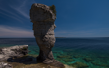 Stone Pillar by the Water Banco de Imagens - 80481381