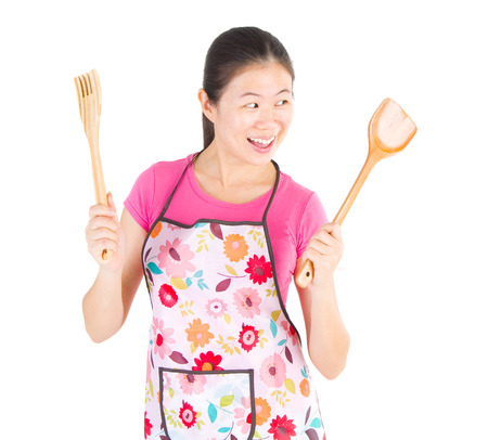 cook house: portrait of excited female chef or house wife ready to cook and standing isolated on white background.