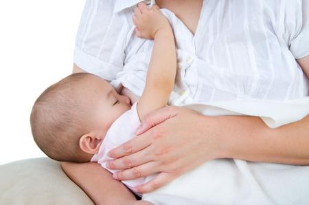 breastfeeding: Asian mother breastfeeding her baby girl