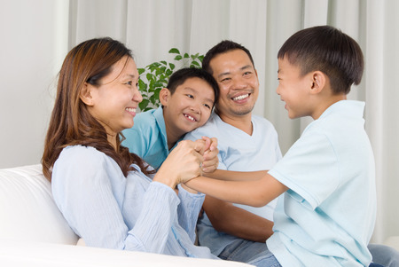 southeast asian: Asian family having fun at home Stock Photo